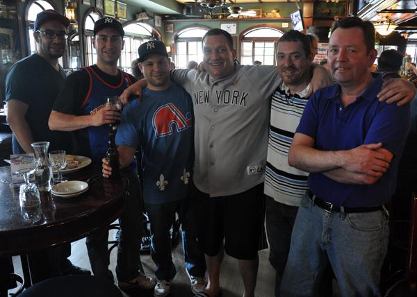 Five patrons gather at Rambling House Bar for a sports smorgasbord