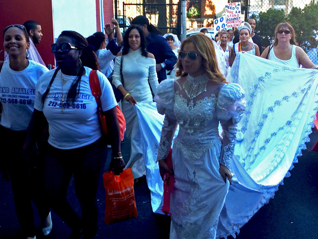 Supporters march throughout  Manhattan and the Bronx dressed in their white wedding gowns.
